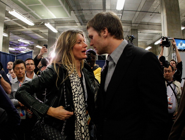 INDIANAPOLIS, IN - FEBRUARY 05:  Tom Brady #12 of the New England Patriots chats with his wife Gisele Bundchen after losing to the New York Giants by a score of 21-17 in Super Bowl XLVI at Lucas Oil Stadium on February 5, 2012 in Indianapolis, Indiana.  (Photo by Rob Carr/Getty Images)