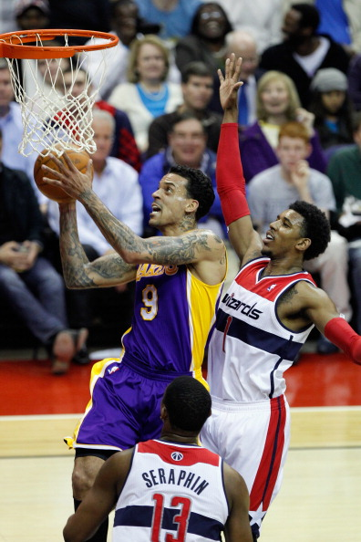 WASHINGTON, DC - MARCH 07: Matt Barnes #9 of the Los Angeles Lakers puts up a shot in front of Nick Young #1 of the Washington Wizards during the first half at the Verizon Center on March 7, 2012 in Washington, DC. NOTE TO USER: User expressly acknowledges and agrees that, by downloading and or using this photograph, User is consenting to the terms and conditions of the Getty Images License Agreement.  (Photo by Rob Carr/Getty Images)