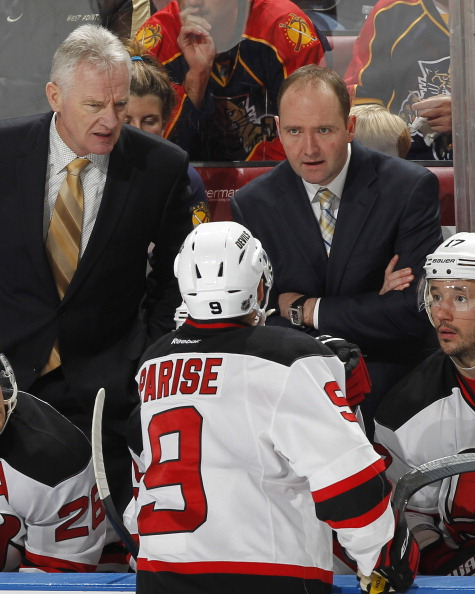 SUNRISE, FL - APRIL 21: Head coach Peter DeBoer talks to Zach Parise #9 of the New Jersey Devils during a time out against the Florida Panthers in Game Five of the Eastern Conference Quarterfinals during the 2012 NHL Stanley Cup Playoffs at the BankAtlantic Center on April 21, 2012  in Sunrise, Florida. The Panthers defeated the Devils 3-0. (Photo by Joel Auerbach/Getty Images)
