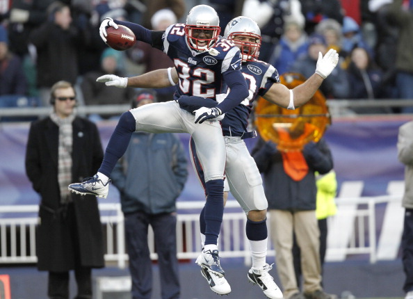 FOXBORO, MA - DECEMBER 24:  Devin McCourty #32 of the New England Patriots celebrates intercepting a Miami Dolphins pass with teammate Rob Ninkovich during the fourth quarter of New England's 27-24 win at Gillette Stadium on December 24, 2011 in Foxboro, Massachusetts.  (Photo by Winslow Townson/Getty Images)