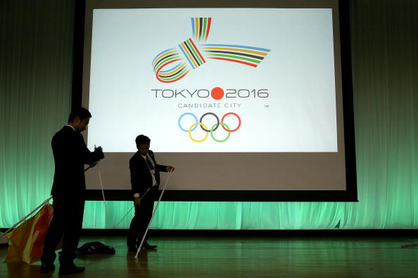 TOKYO - OCTOBER 03:  Members of staff 'take away the flags of Tokyo's bid for the 2016 Summer Olympic Games on the stage after Tokyo was eliminated in the second ballot for the 2016 Olympic host city, at Tokyo Metropolitan Government headquarters on October 3, 2009 in Tokyo, Japan. Chicago was the first city to be eliminated, followed by Tokyo. Rio de Janeiro won the right to host the 2016 Summer Olympic Games, defeating Madrid in the final ballot.  (Photo by Kiyoshi Ota/Getty Images)