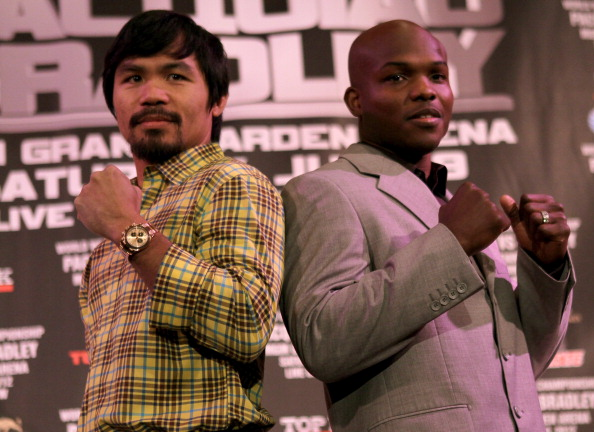 BEVERLY HILLS, CA - FEBRUARY 21:  Manny Pacquiao (L) and Timothy Bradley pose fpr photographers at a press conference announcing their upcoming World Boxing Organization welterweight championship fight at The Beverly Hills Hotel on February 21, 2012 in Beverly Hills, California.  (Photo by Stephen Dunn/Getty Images)
