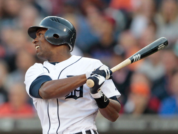 DETROIT, MI - MAY 16: Austin Jackson #14 of the Detroit Tigers singles to center field scoring Brennan Boesch #26 in the second inning during the game against the Minnesota Twins at Comerica Park on May 16, 2012 in Detroit, Michigan.  (Photo by Leon Halip/Getty Images)