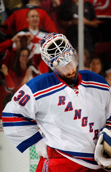 NEWARK, NJ - MAY 25:  Henrik Lundqvist #30 of the New York Rangers looks on after losing Game Six of the Eastern Conference Final during the 2012 NHL Stanley Cup Playoffs to the New Jersey Devils by a score of 3-2 at the Prudential Center on May 25, 2012 in Newark, New Jersey.  (Photo by Bruce Bennett/Getty Images)