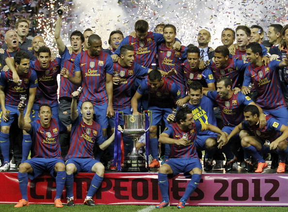 MADRID, SPAIN - MAY 25: Players of Barcelona pose with the trophy in celebration after their victory in the Copa del Rey Final match between Athletic Bilbao and Barcelona at Vicente Calderon Stadium on May 25, 2012 in Madrid, Spain. (Photo by Angel Martinez/Getty Images)
