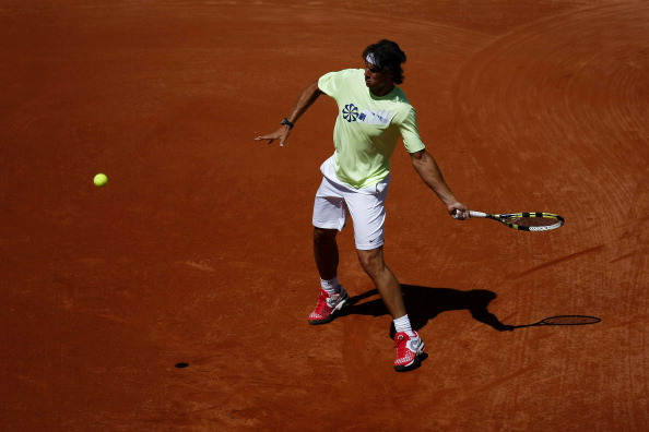 PARIS, FRANCE - MAY 25:  Rafael Nadal of Spain hits a forehand during a practice session ahead of the French Open at Roland Garros on May 25, 2012 in Paris, France.  (Photo by Dan Istitene/Getty Images)