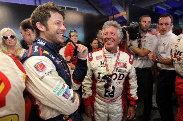 INDIANAPOLIS, IN - MAY 27:  (L-R) Marco Andretti, driver of the #26 Team RC Cola Chevrolet shares a laugh with his grandfather Mario Andretti prior to the start of the IZOD IndyCar Series 96th running of the Indianpolis 500 mile race at the Indianapolis Motor Speedway on May 27, 2012 in Indianapolis, Indiana.  (Photo by Nick Laham/Getty Images)