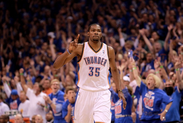 OKLAHOMA CITY, OK - MAY 21:  Kevin Durant #35 of the Oklahoma City Thunder reacts after a three-point shot against the Los Angeles Lakers during Game Five of the Western Conference Semifinals of the 2012 NBA Playoffs at Chesapeake Energy Arena on May 21, 2012 in Oklahoma City, Oklahoma.  NOTE TO USER: User expressly acknowledges and agrees that, by downloading and or using this photograph, User is consenting to the terms and conditions of the Getty Images License Agreement.  (Photo by Ronald Martinez/Getty Images)