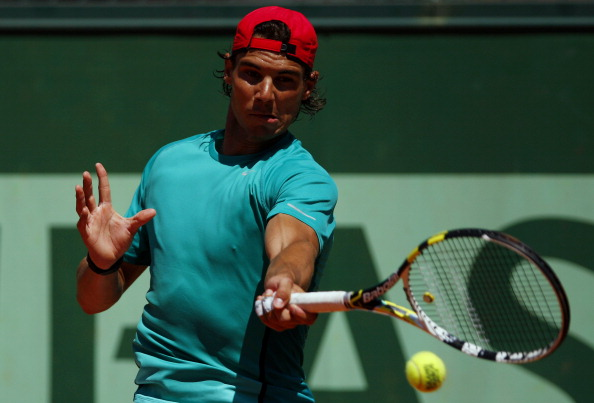 PARIS, FRANCE - MAY 26:  Rafael Nadal of Spain plys a forehand during a practice session ahead of the 2012 French Open at Roland Garros on May 26, 2012 in Paris, France.  (Photo by Dan Istitene/Getty Images)