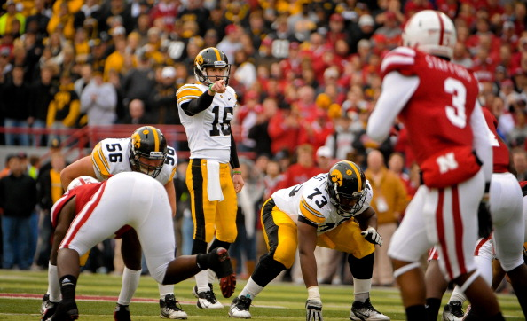 LINCOLN, NE - NOVEMBER 25: Quarterback James Vandenberg #16 of the Iowa Hawkeyes points out the Nebraska Cornhusker defense during their game at Memorial Stadium November 25, 2011 in Lincoln, Nebraska. Nebraska defeated Iowa 20-7. (Photo by Eric Francis/Getty Images)