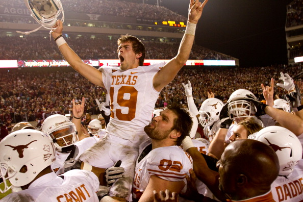 COLLEGE STATION, TX - NOVEMBER 24:  Justin Tucker #19 of the Texas Longhorns celebrates with teammates after kicking the winning field goal as time expired  in the second half of a game against the Texas A&M Aggies at Kyle Field on November 24, 2011 in College Station, Texas. Texas won the game, 27-25. (Photo by Darren Carroll/Getty Images)