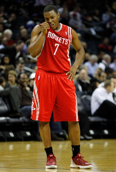 CHARLOTTE, NC - JANUARY 10:  Kyle Lowry #7 of the Houston Rockets against the Charlotte Bobcats during their game at Time Warner Cable Arena on January 10, 2012 in Charlotte, North Carolina.   NOTE TO USER: User expressly acknowledges and agrees that, by downloading and or using this photograph, User is consenting to the terms and conditions of the Getty Images License Agreement.  (Photo by Streeter Lecka/Getty Images)