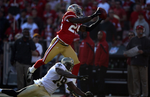 SAN FRANCISCO, CA - JANUARY 14:  Tarell Brown #25 of the San Francisco 49ers makes a catch over  Devery Henderson #19 of the New Orleans Saints in the second quarter of the NFC Divisional playoff game at Candlestick Park on January 14, 2012 in San Francisco, California. (Photo by Jed Jacobsohn/Getty Images)