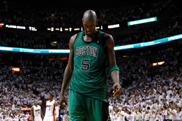 MIAMI, FL - MAY 30:  Kevin Garnett #5 of the Boston Celtics stands on the court with his head down against the Miami Heat in Game Two of the Eastern Conference Finals in the 2012 NBA Playoffs on May 30, 2012 at American Airlines Arena in Miami, Florida. NOTE TO USER: User expressly acknowledges and agrees that, by downloading and or using this photograph, User is consenting to the terms and conditions of the Getty Images License Agreement.  (Photo by Mike Ehrmann/Getty Images)