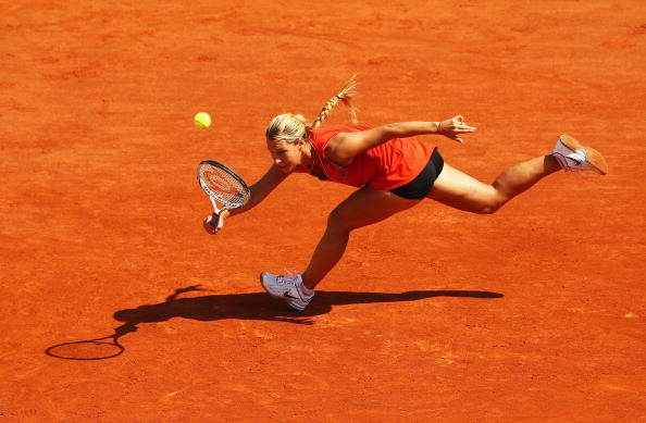PARIS, FRANCE - MAY 28:  Dominika Cibulkova of Slovakia stretches to hit a forehand in the women's singles first round match between Kristina Mladenovic of France and Dominika Cibulkova of Slovakia during day two of the French Open at Roland Garros on May 28, 2012 in Paris, France.  (Photo by Clive Brunskill/Getty Images)