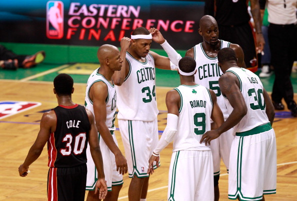 BOSTON, MA - JUNE 03:  Ray Allen #20, Paul Pierce #34, Rajon Rondo #9, Kevin Garnett #5 and Brandon Bass #30 of the Boston Celtics talk on court against Norris Cole #30 of the Miami Heat in Game Four of the Eastern Conference Finals in the 2012 NBA Playoffs on June 3, 2012 at TD Garden in Boston, Massachusetts. NOTE TO USER: User expressly acknowledges and agrees that, by downloading and or using this photograph, User is consenting to the terms and conditions of the Getty Images License Agreement.  (Photo by Jared Wickerham/Getty Images)