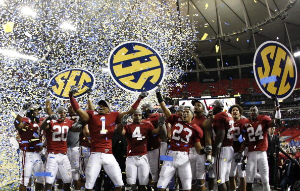 ATLANTA - DECEMBER 5:  The Alabama Crimson Tide celebrate as confetti falls after their 32-13 win against the Florida Gators during the SEC Championship game at Georgia Dome on December 5, 2009 in Atlanta, Georgia.  (Photo by Kevin C. Cox/Getty Images)