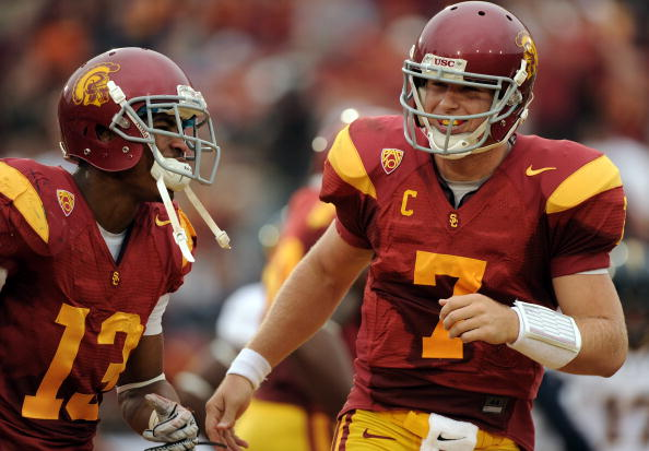 LOS ANGELES, CA - OCTOBER 16:  Matt Barkley #7 and Robert Woods #13 of the USC Trojans celebrate a touchdown for a 28-0 lead over the California Golden Bears during the second quarter at Los Angeles Memorial Coliseum on October 16, 2010 in Los Angeles, California.  (Photo by Harry How/Getty Images)