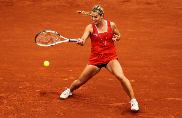 PARIS, FRANCE - JUNE 03:  Dominika Cibulkova of Slovakia plays a forehand in her women's singles fourth round match against Victoria Azarenka of Belarus during day 8 of the French Open at Roland Garros on June 3, 2012 in Paris, France.  (Photo by Matthew Stockman/Getty Images)