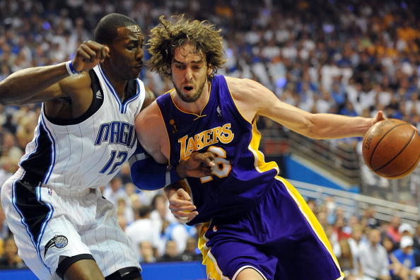 ORLANDO, FL - JUNE 14:  Pau Gasol #16 of the Los Angeles Lakers drives on Dwight Howard #12 of the Orlando Magic in Game Five of the 2009 NBA Finals on June 14, 2009 at Amway Arena in Orlando, Florida.  NOTE TO USER:  User expressly acknowledges and agrees that, by downloading and or using this photograph, User is consenting to the terms and conditions of the Getty Images License Agreement.  (Photo by Ronald Martinez/Getty Images)