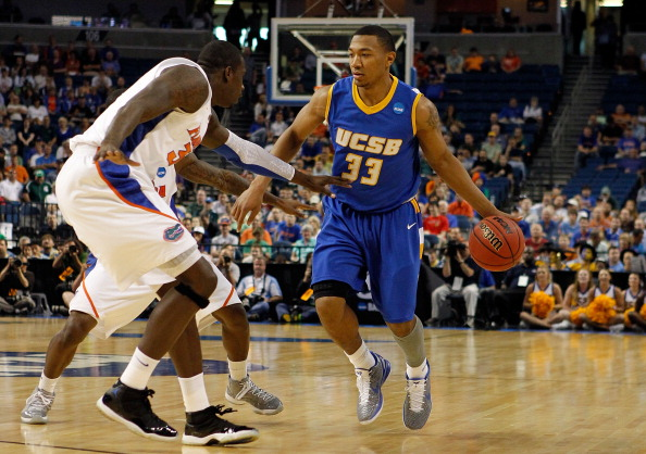 TAMPA, FL - MARCH 17:  Orlando Johnson #33 of the UC Santa Barbara Gauchos drives against Vernon Macklin #32 of the Florida Gators during the second round of the 2011 NCAA men's basketball tournament at St. Pete Times Forum on March 17, 2011 in Tampa, Florida.  (Photo by J. Meric/Getty Images)