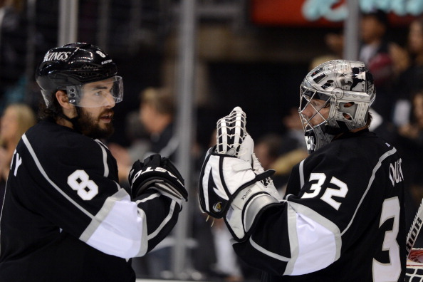 LOS ANGELES, CA - JUNE 04:  Drew Doughty #8 and Jonathan Quick #32 of the Los Angeles Kings celebrate after the Kings's fourth goal in Game Three of the 2012 Stanley Cup Final against the New Jersey Devils at Staples Center on June 4, 2012 in Los Angeles, California. The Kings defeated the Devils 4-0. (Photo by Harry How/Getty Images)