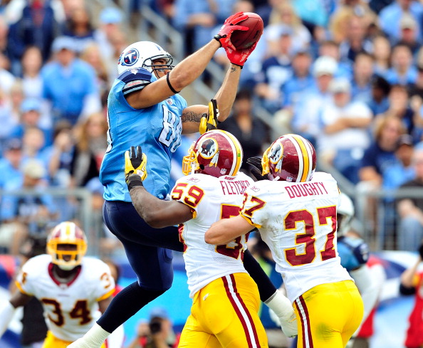 NASHVILLE, TN - NOVEMBER 21:  London Fletcher #59 and Reed Doughty #37 of the Washington Redskins force Bo Scaife #80 of the Tennessee Titans out of the end zone to prevent a touchdown at LP Field on November 21, 2010 in Nashville, Tennessee. The Redskins won 19-16 in overtime.  (Photo by Grant Halverson/Getty Images)