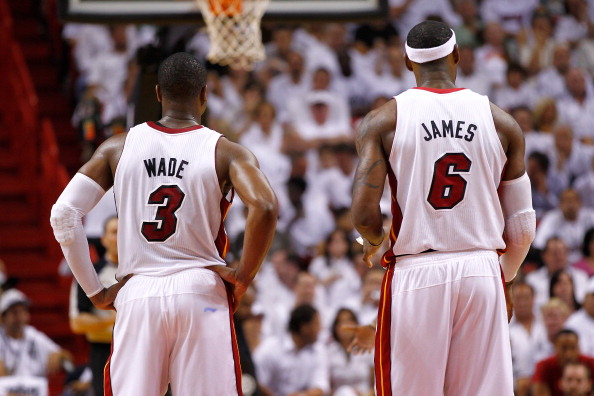 MIAMI, FL - JUNE 05:  (L-R) Dwyane Wade #3 and LeBron James #6 of the Miami Heat stand on court against the Boston Celtics in Game Five of the Eastern Conference Finals in the 2012 NBA Playoffs on June 5, 2012 at American Airlines Arena in Miami, Florida. NOTE TO USER: User expressly acknowledges and agrees that, by downloading and or using this photograph, User is consenting to the terms and conditions of the Getty Images License Agreement.  (Photo by Mike Ehrmann/Getty Images)