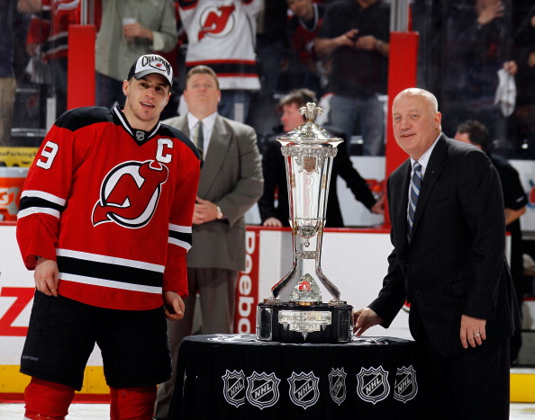 NEWARK, NJ - MAY 25:  Zach Parise #9 of the New Jersey Devils is presented with the Prince of Wales Trophy by NHL Deputy Commissioner Bill Daly after in Game Six of the Eastern Conference Final during the 2012 NHL Stanley Cup Playoffs against the New York Rangers at the Prudential Center on May 25, 2012 in Newark, New Jersey.  (Photo by Bruce Bennett/Getty Images)