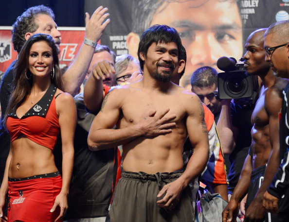 LAS VEGAS, NV - JUNE 08:  Boxers Manny Pacquiao (C) and Timothy Bradley (R) pose during the official weigh-in for their bout at the MGM Grand Garden Arena on June 8, 2012 in Las Vegas, Nevada. Pacquiao will defend his WBO welterweight title against Bradley on June 9 in Las Vegas.  (Photo by Kevork Djansezian/Getty Images)