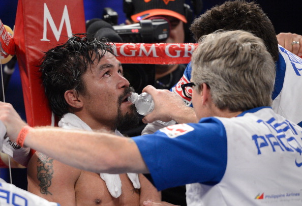 LAS VEGAS, NV - JUNE 09:  Manny Pacquiao sits in his corner between rounds during his bout against Timothy Bradley at MGM Grand Garden Arena on June 9, 2012 in Las Vegas, Nevada.  (Photo by Kevork Djansezian/Getty Images)