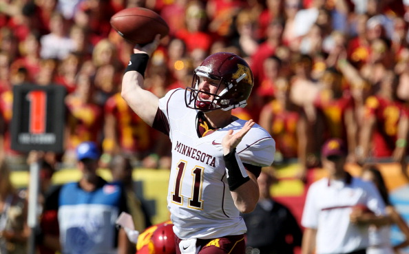 LOS ANGELES - SEPTEMBER 3: Quarterback Max Shortell #11 of the Minnesota Golden Gophers throws a pass against the USC Trojans at the Los Angeles Memorial Coliseum on September 3, 2011 in Los Angeles, California.  USC won 19-17. (Photo by Stephen Dunn/Getty Images)