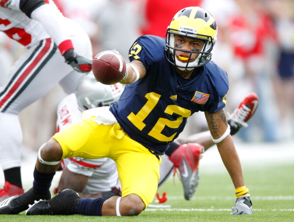 ANN ARBOR, MI - NOVEMBER 26:  Roy Roundtree #12 of the Michigan Wolverines reacts after a first quarter first down catch while playing the Ohio State Buckeyes at Michigan Stadium on November 26, 2011 in Ann Arbor, Michigan. (Photo by Gregory Shamus/Getty Images)