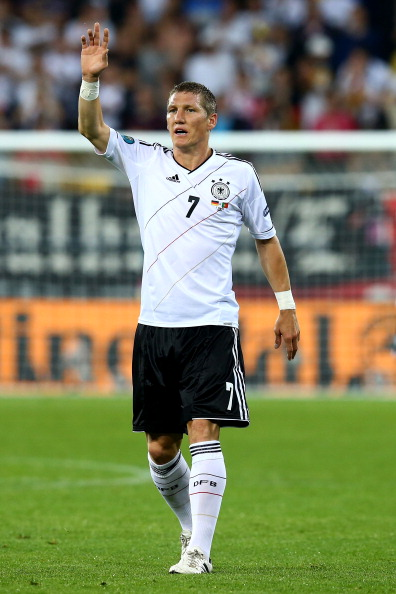 L'VIV, UKRAINE - JUNE 09: Bastian Schweinsteiger of Germany in action  during the UEFA EURO 2012 group B match between Germany and Portugal at Arena Lviv on June 9, 2012 in L'viv, Ukraine.  (Photo by Martin Rose/Getty Images)