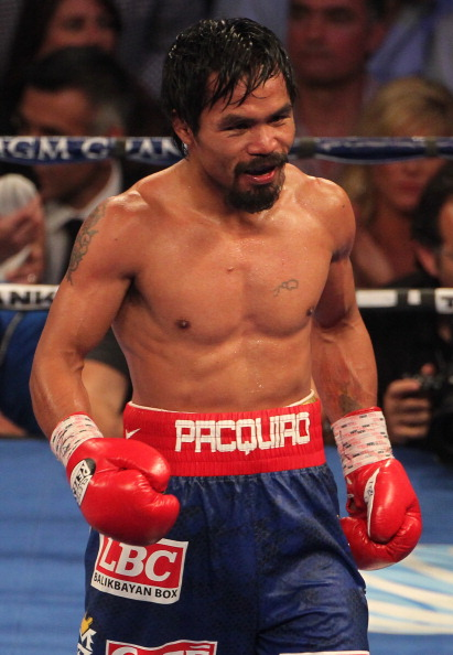 LAS VEGAS, NV - JUNE 09:  Manny Pacquiao walks to his corner between rounds during his fight against Timothy Bradley at MGM Grand Garden Arena on June 9, 2012 in Las Vegas, Nevada.  (Photo by Jeff Bottari/Getty Images)