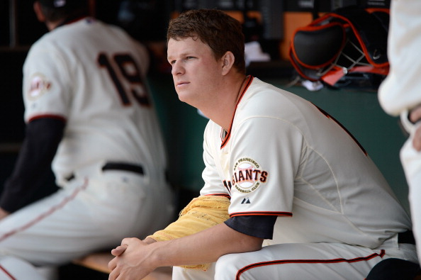 SAN FRANCISCO, CA - MAY 17:  Matt Cain #18 of the San Francisco Giants looks on from the dugout in the bottom of the first inning against the St Louis Cardinals at AT&T Park on May 17, 2012 in San Francisco, California.  (Photo by Thearon W. Henderson/Getty Images)