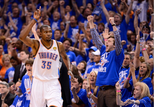 OKLAHOMA CITY, OK - JUNE 12:  Kevin Durant #35 of the Oklahoma City Thunder reacts after making a shot in the second half in Game One of the 2012 NBA Finals at Chesapeake Energy Arena on June 12, 2012 in Oklahoma City, Oklahoma. NOTE TO USER: User expressly acknowledges and agrees that, by downloading and or using this photograph, User is consenting to the terms and conditions of the Getty Images License Agreement.  (Photo by Ronald Martinez/Getty Images)