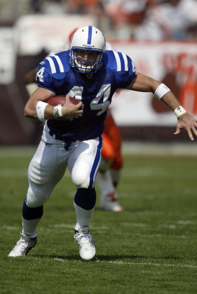 CLEVELAND- SEPTEMBER 7:  Tight end Dallas Clark #44 of the Indianapolis Colts runs the ball for yardage during a game against the Cleveland Browns on September 7, 2003 at Cleveland Browns Stadium in Cleveland, Ohio. The Colts defeated the Browns 9-6. (Photo by Tom Pidgeon/Getty Images)