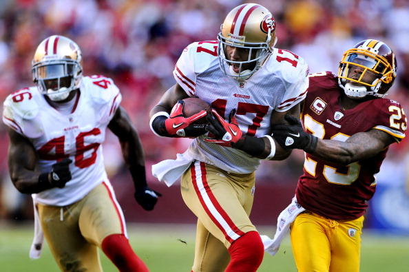 LANDOVER, MD - NOVEMBER 6: Wide receiver Braylon Edwards #17 of the San Francisco 49ers eludes cornerback DeAngelo Hall #23 of the Washington Redskins during the third quarter at FedExField on November 6, 2011 in Landover, Maryland. The San Francisco 49ers won, 19-11. (Photo by Patrick Smith/Getty Images)