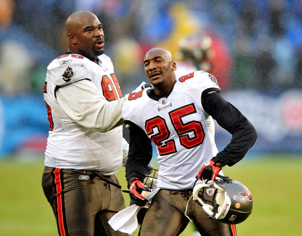 NASHVILLE, TN - NOVEMBER 27:  Albert Hanesworth #95 consoles Aqib Talib #25 of the Tampa Bay Buccaneers as Talib reacts after a teammate's game-ending fumble against the Tennessee Titans during play at LP Field on November 27, 2011 in Nashville, Tennessee. The Titans won 23-17.  (Photo by Grant Halverson/Getty Images)