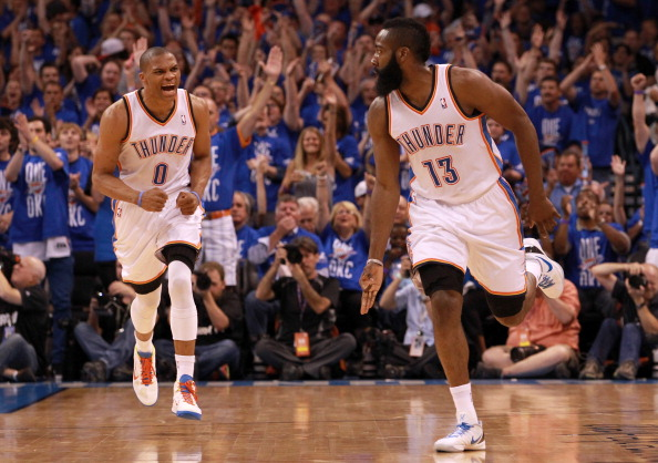 OKLAHOMA CITY, OK - MAY 31:  (R-L) James Harden #13 reacts after making a three-pointer alongside teammate Russell Westbrook #0 of the Oklahoma City Thunder in the first half against the San Antonio Spurs in Game Three of the Western Conference Finals of the 2012 NBA Playoffs at Chesapeake Energy Arena on May 31, 2012 in Oklahoma City, Oklahoma. NOTE TO USER: User expressly acknowledges and agrees that, by downloading and or using this photograph, User is consenting to the terms and conditions of the Getty Images License Agreement.  (Photo by Ronald Martinez/Getty Images)