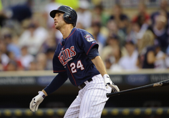 MINNEAPOLIS, MN - JUNE 15: Trevor Plouffe #24 of the Minnesota Twins hits a solo home run against the Milwaukee Brewers during the fifth inning on June 15, 2012 at Target Field in Minneapolis, Minnesota. (Photo by Hannah Foslien/Getty Images)