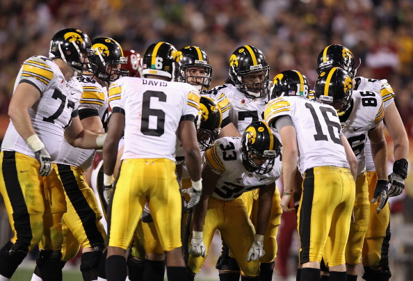 TEMPE, AZ - DECEMBER 30:   The Iowa Hawkeyes huddle up around quarterback James Vandenberg #16 during the Insight Bowl against the Oklahoma Sooners at Sun Devil Stadium on December 30, 2011 in Tempe, Arizona.  The Sooners defeated the Hawkeyes 31-14.  (Photo by Christian Petersen/Getty Images)