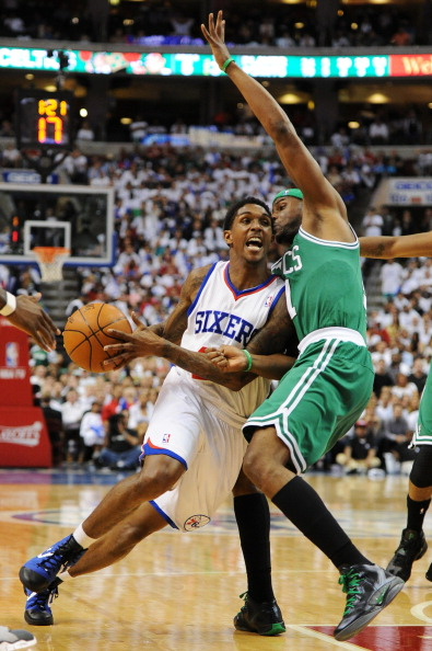 PHILADELPHIA, PA - MAY 18: Lou Williams #23 of the Philadelphia 76ers drives and is fouled by Keyon Dooling #51 of the Boston Celtics in Game Four of the Eastern Conference Semifinals in the 2012 NBA Playoffs at the Wells Fargo Center on May 18, 2012 in Philadelphia, Pennsylvania. The Sixers won 92-83. NOTE TO USER: User expressly acknowledges and agrees that, by downloading and or using this photograph, User is consenting to the terms and conditions of the Getty Images License Agreement. (Photo by Drew Hallowell/Getty Images)