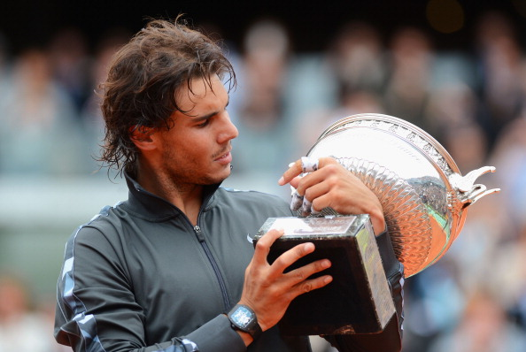 PARIS, FRANCE - JUNE 11:  Rafael Nadal of Spain poses with the Coupe des Mousquetaires trophy in the men's singles final against Novak Djokovic of Serbia during day 16 of the French Open at Roland Garros on June 11, 2012 in Paris, France.  (Photo by Mike Hewitt/Getty Images)