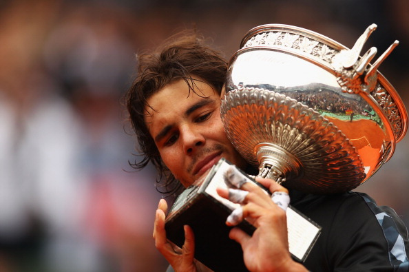 PARIS, FRANCE - JUNE 11:  Rafael Nadal of Spain poses with the Coupe des Mousquetaires trophy in the men's singles final against Novak Djokovic of Serbia during day 16 of the French Open at Roland Garros on June 11, 2012 in Paris, France.  (Photo by Clive Brunskill/Getty Images)