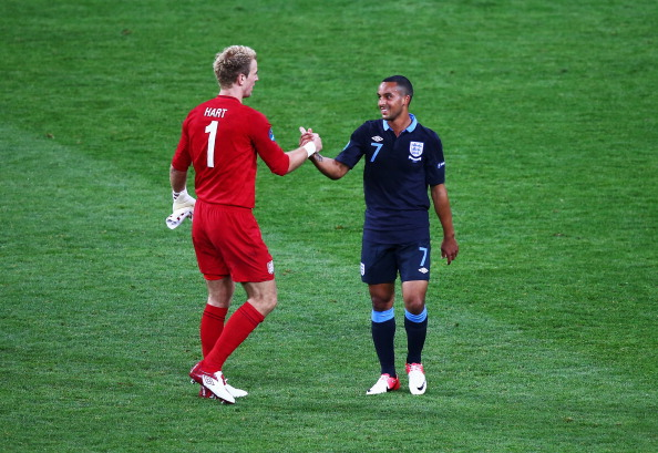 KIEV, UKRAINE - JUNE 15:  Joe Hart of England shakes hands with team mate Theo Walcott after victory in the UEFA EURO 2012 group D match between Sweden and England at The Olympic Stadium on June 15, 2012 in Kiev, Ukraine.  (Photo by Martin Rose/Getty Images)