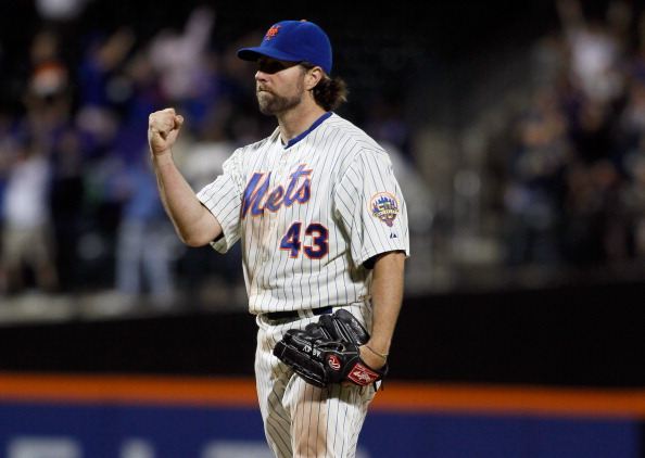 NEW YORK, NY - JUNE 18:  R.A. Dickey #43 of the New York Mets celebrates after pitching a complete game one hitter against the Baltimore Orioles at CitiField on June 18, 2012 in the Flushing neighborhood of the Queens borough of New York City. R.A. Dickey pitches a second consecutive one hitter, striking out career-high 13 batters, as the Mets defeated the Orioles 4-0.  (Photo by Mike Stobe/Getty Images)