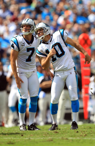 CHARLOTTE, NC - SEPTEMBER 25:   Olindo Mare #10 of the Carolina Panthers and Jason Baker #7 during their game against the Jacksonville Jaguars at Bank of America Stadium on September 25, 2011 in Charlotte, North Carolina.  (Photo by Streeter Lecka/Getty Images)