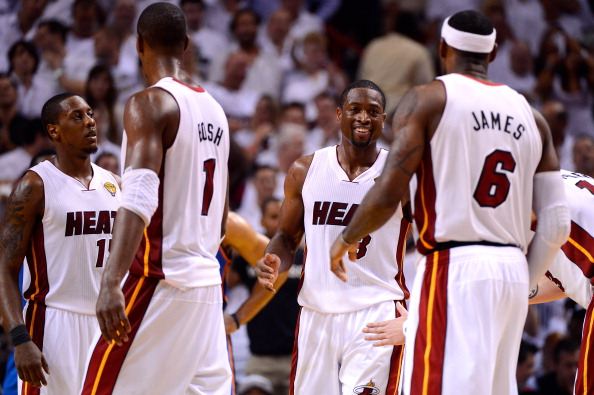 MIAMI, FL - JUNE 21:  (L-R) Mario Chalmers #15, Chris Bosh #1, Dwyane Wade #3 and LeBron James #6 of the Miami Heat celebrate during the fourth quarter against the Oklahoma City Thunder in Game Five of the 2012 NBA Finals on June 21, 2012 at American Airlines Arena in Miami, Florida. NOTE TO USER: User expressly acknowledges and agrees that, by downloading and or using this photograph, User is consenting to the terms and conditions of the Getty Images License Agreement.  (Photo by Ronald Martinez/Getty Images)